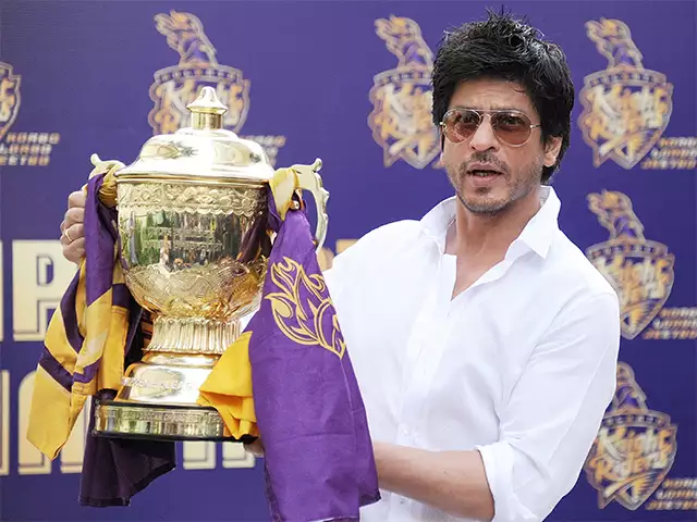Shahrukh khan holding a trophy for Kolkotta knight riders